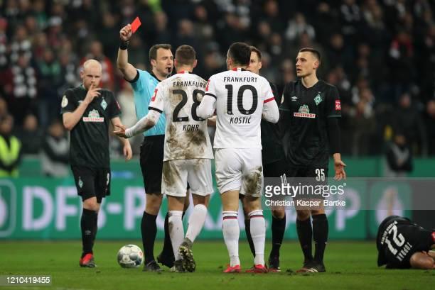 Filip Kostic of Eintracht Frankfurt is shown a red card by referee Felix Zwayer during the DFB Cup quarterfinal match between Eintracht Frankfurt and...