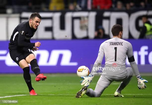 Filip Kostic of Eintracht Frankfurt scores his teams fourth goal during the UEFA Europa League round of 32 first leg match between Eintracht...