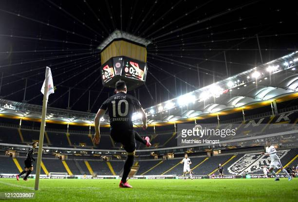 Filip Kostic of Eintracht Frankfurt takes a corner kick during the UEFA Europa League round of 16 first leg match between Eintracht Frankfurt and FC...