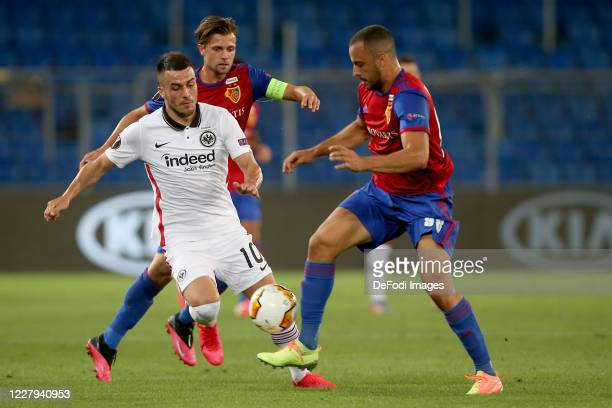 Filip Kostic of Eintracht Frankfurt, Valentin Stocker of FC Basel 1893 and Arthur Cabral of FC Basel 1893 battle for the ball during the UEFA Europa...