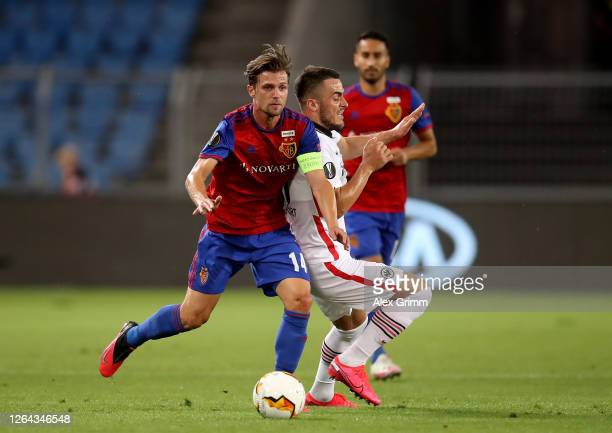 Filip Kostic of Eintracht Frankfurt with Valentin Stocker of Basel during the UEFA Europa League round of 16 second leg match between FC Basel and...