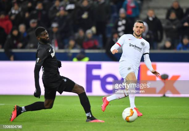 Filip Kostic of Frankfurt and Jerome Onguene of Salzburg in action during the UEFA Europa League round of 32 second leg match between RB Salzburg and...
