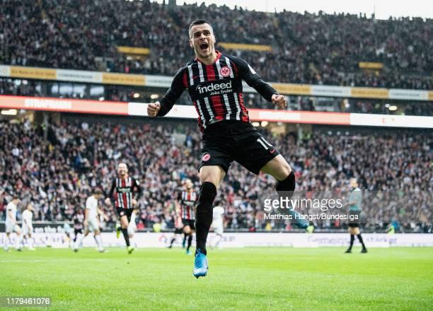 Filip Kostic of Frankfurt celebrates after scoring his team's first goal during the Bundesliga match between Eintracht Frankfurt and FC Bayern...