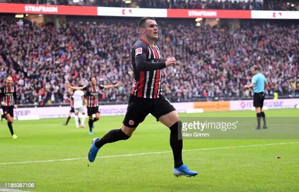 Filip Kostic of Frankfurt celebrates his team's first goal during the Bundesliga match between Eintracht Frankfurt and FC Bayern Muenchen at...