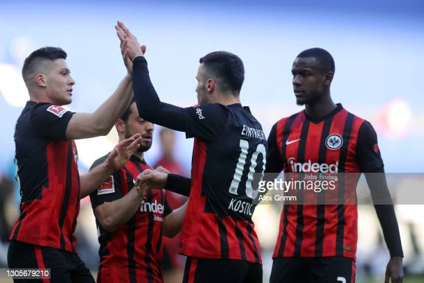 Filip Kostic of Frankfurt celebrates his team's first goal with teammates Luka Jovic Amin Younes and Evan N'Dicka during the Bundesliga match between...