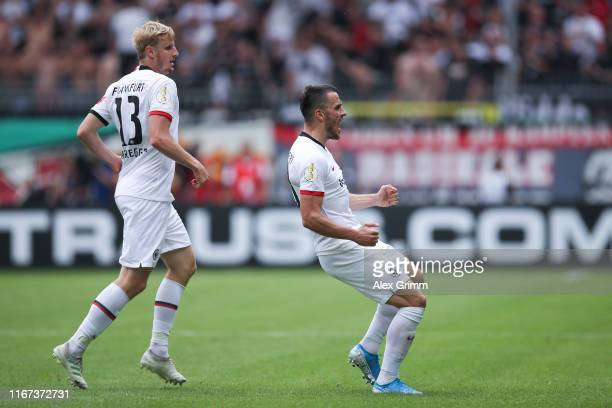 Filip Kostic of Frankfurt celebrates his team's second goal with team mate Martin Hinteregger during the DFB Cup first round match between SV Waldhof...