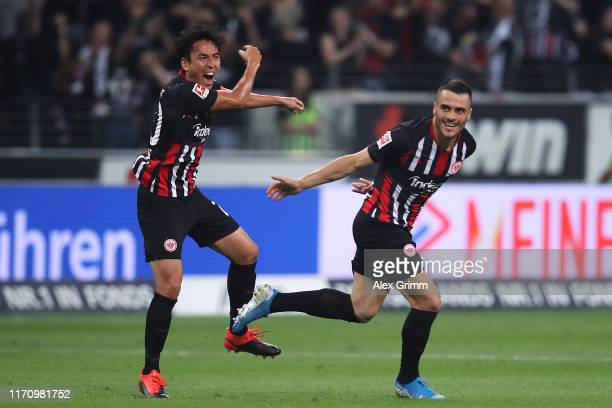 Filip Kostic of Frankfurt celebrates his team's second goal with team mate Makoto Hasebe during the second leg of the UEFA Europa League playoff...
