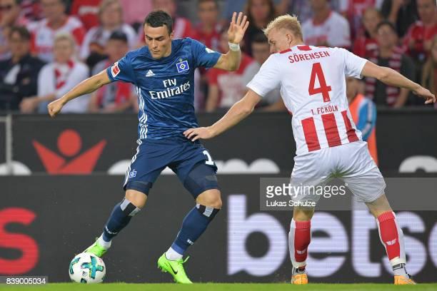Filip Kostic of Hamburg and Frederik Sorensen of Koeln fight for the ball during the Bundesliga match between 1 FC Koeln and Hamburger SV at...