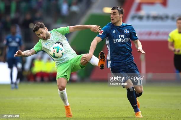 Filip Kostic of Hamburg and Renato Steffen of Wolfsburg compete for the ball during the Bundesliga match between VfL Wolfsburg and Hamburger SV at...