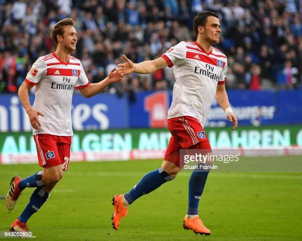 Filip Kostic of Hamburg celebrates after he scored a goal to make it 1:1 during the Bundesliga match between Hamburger SV and FC Schalke 04 at...
