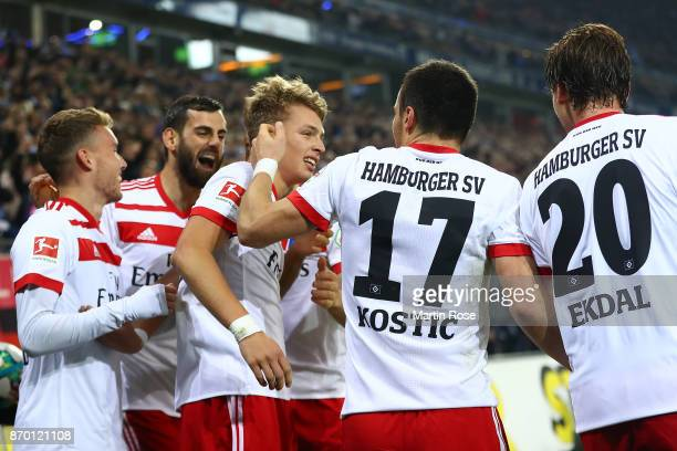 Filip Kostic of Hamburg celebrates with JannFiete Arp of Hamburg after Arp scored a goal to make it 31 during the Bundesliga match between Hamburger...
