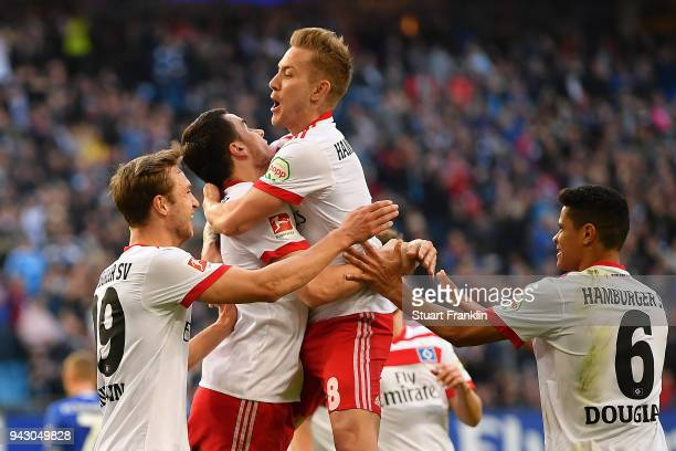 Filip Kostic of Hamburg celebrates with Lewis Holtby of Hamburg and his team after he scored a goal to make it 11 during the Bundesliga match between...