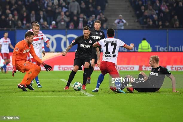 Filip Kostic of Hamburg falls in the penalty area during the Bundesliga match between Hamburger SV and 1 FC Koeln at Volksparkstadion on January 20...
