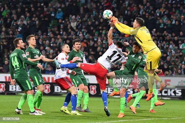 Filip Kostic of Hamburg fights for the ball with goalkeeper Jiri Pavlenka of Bremen during the Bundesliga match between SV Werder Bremen and...