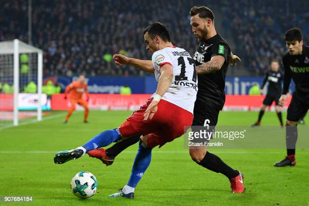 Filip Kostic of Hamburg fights for the ball with Marco Hoeger of Koeln during the Bundesliga match between Hamburger SV and 1 FC Koeln at...