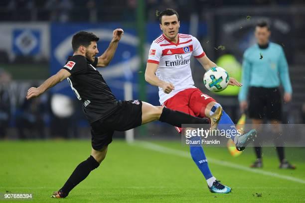 Filip Kostic of Hamburg fights for the ball with Milos Jojic of Koeln during the Bundesliga match between Hamburger SV and 1 FC Koeln at...