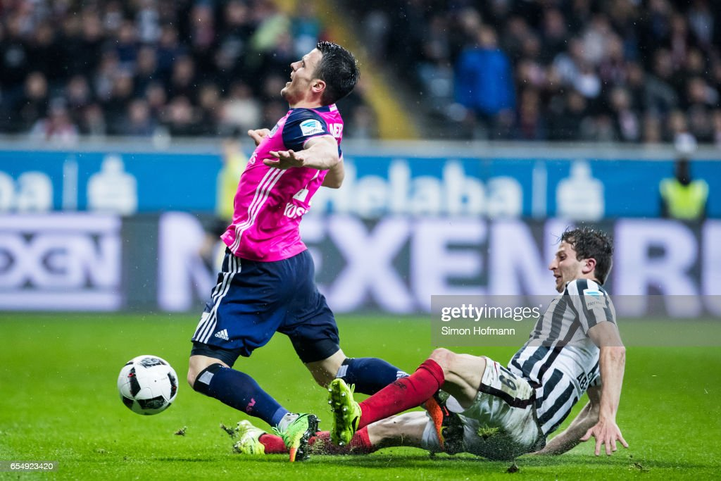 Filip Kostic of Hamburg is challenged by David Abraham of Frankfurt during the Bundesliga match between Eintracht Frankfurt and Hamburger SV at Commerzbank-Arena on March 18, 2017 in Frankfurt am Main, Germany.
