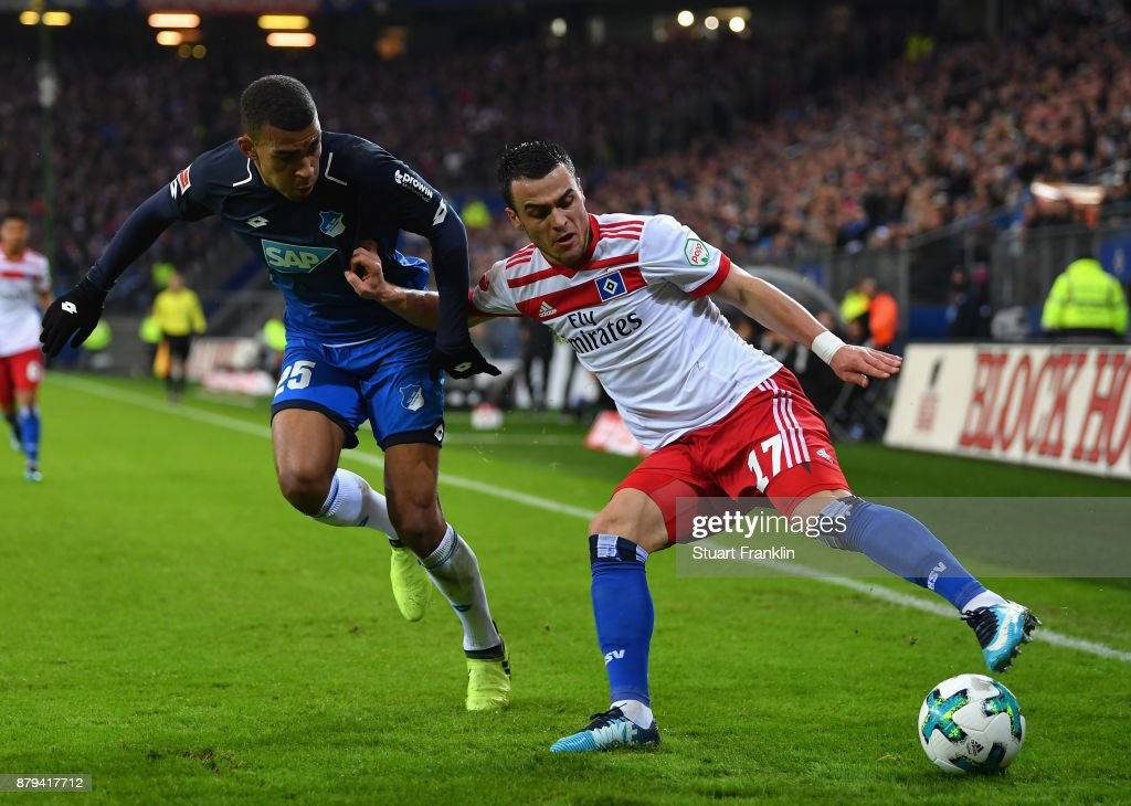 Filip Kostic of Hamburg is challenged by Kevin Akpoguma of Hoffenheim during the Bundesliga match between Hamburger SV and TSG 1899 Hoffenheim at Volksparkstadion on November 26, 2017 in Hamburg, Germany.