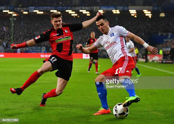 Filip Kostic of Hamburg is challenged by Lukas Kbler of Freiburg during the Bundesliga match between Hamburger SV and SC Freiburg at Volksparkstadion...