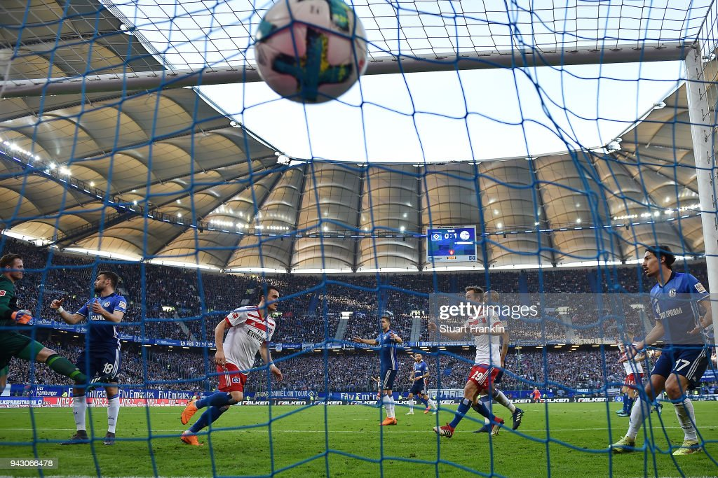 Filip Kostic of Hamburg (l) scores a goal to make it 1:1 during the Bundesliga match between Hamburger SV and FC Schalke 04 at Volksparkstadion on April 7, 2018 in Hamburg, Germany.