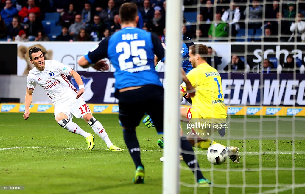 Filip Kostic (R) of Hamburg scores the opening goal during the Bundesliga match between TSG 1899 Hoffenheim and Hamburger SV at Wirsol Rhein-Neckar-Arena on November 20, 2016 in Sinsheim, Germany.