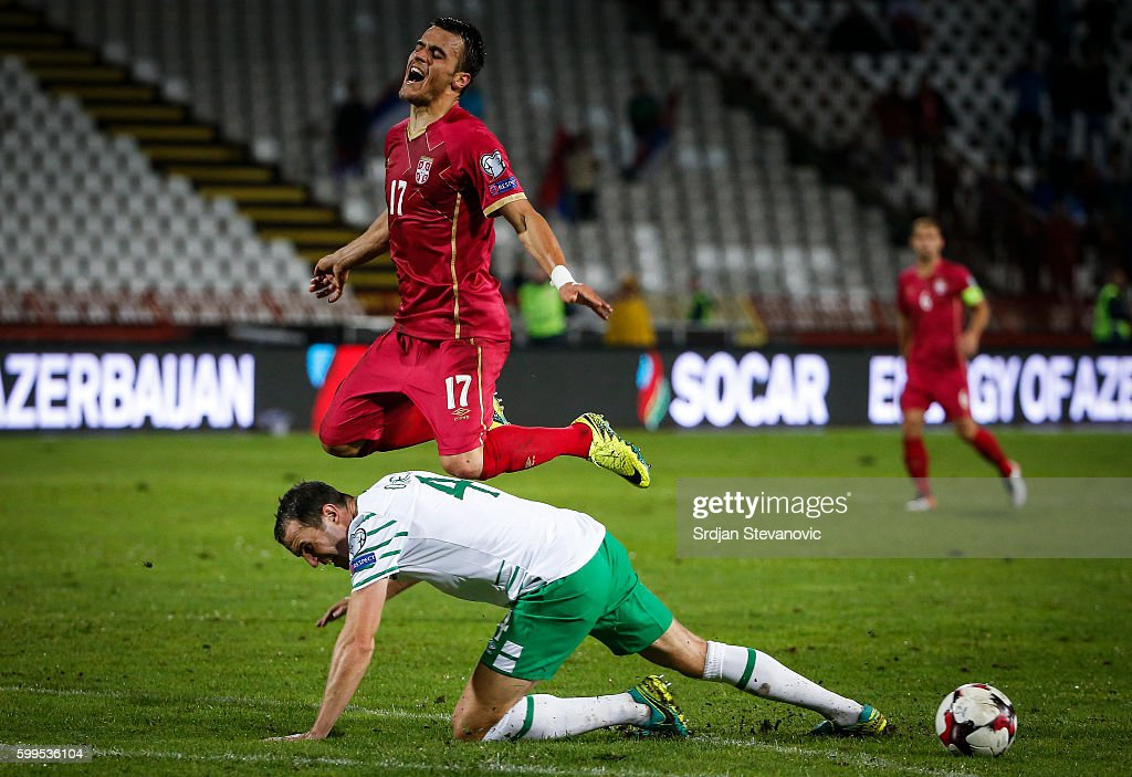 Filip Kostic (TOP)) of Serbia is challenged by John OÕShea (DOWN) of Ireland during the FIFA 2018 World Cup Qualifier between Serbia and Ireland at stadium Rajko Mitic on September 5, 2016 in Belgrade.