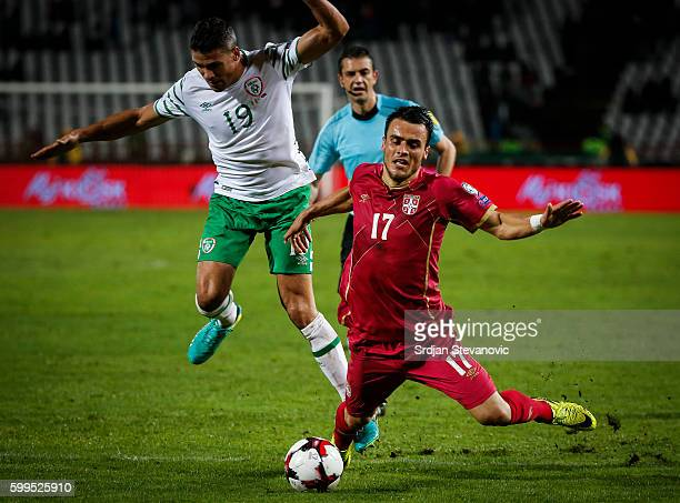 Filip Kostic of Serbia is fouled Jon Walters of Ireland during the FIFA 2018 World Cup Qualifier between Serbia and Ireland at stadium Rajko Mitic on...