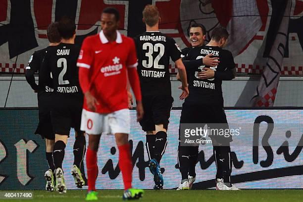 Filip Kostic of Stuttgart celebrates his team's first goal with team mates during the Bundesliga match between 1 FSV Mainz 05 and VfB Stuttgart at...