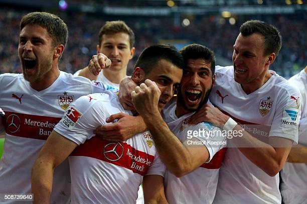 Filip Kostic of Stuttgart celebrtaes the forth goal with Florian Klein Emiliano Insua and Kevin Grosskreutz during the Bundesliga match between...