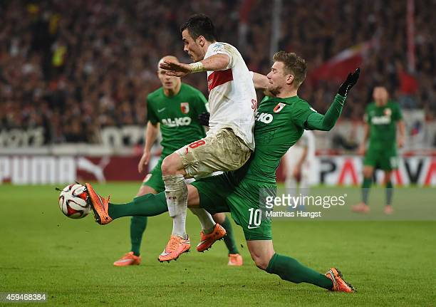 Filip Kostic of Stuttgart is challenged by Daniel Baier of Augsburg during the Bundesliga match between VfB Stuttgart and FC Augsburg at MercedesBenz...