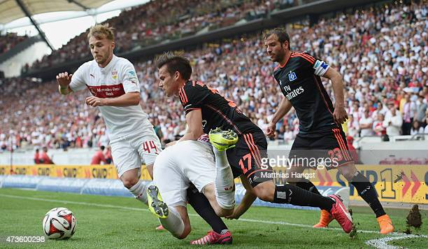 Filip Kostic of Stuttgart is challenged by Zoltan Stieber of Hamburg during the Bundesliga match between VfB Stuttgart and Hamburger SV at...