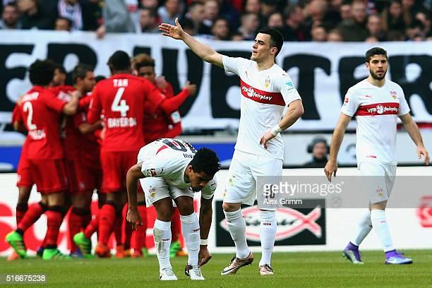 Filip Kostic of Stuttgart reacts after Julian Brandt of Leverkusen scored his team's first goal during the Bundesliga match between VfB Stuttgart and...