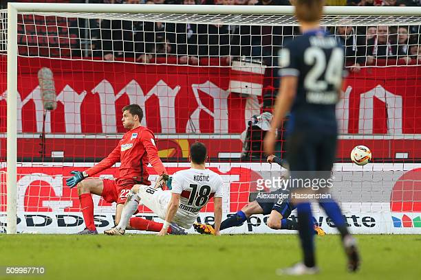 Filip Kostic of Stuttgart scores the second team goal against Rune Jarstein keeper of Hertha during the Bundesliga match between VfB Stuttgart and...