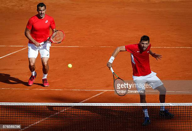 Filip Krajinovic and Nenad ZImonjic of Serbia compete in the doubles match against Jamie Murray and Dominic Inglot of Great Britain during day two of...