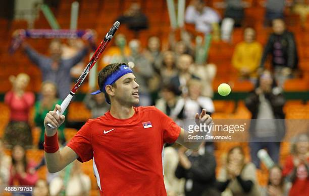 Filip Krajinovic of Serbia celebrate victory against Marco Chiudinelli of Switzerland during the day three of the Davis Cup match between Serbia and...