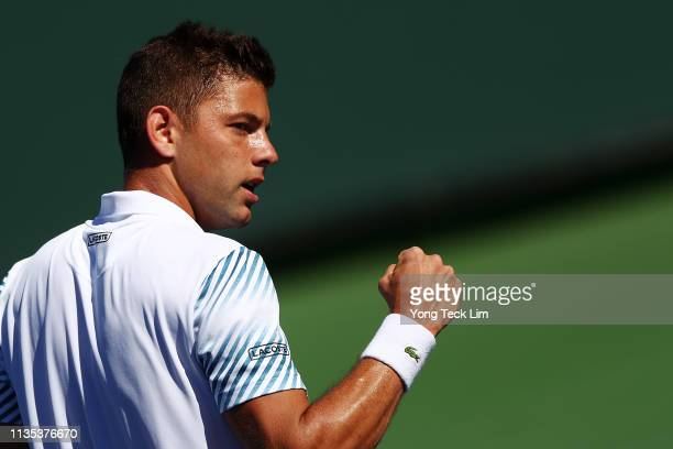 Filip Krajinovic of Serbia celebrates a point against Daniil Medvedev of Russia during their men's singles third round match on Day 9 of the BNP...