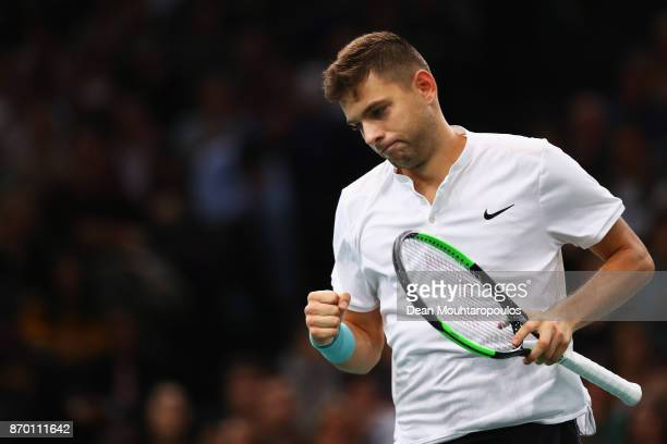 Filip Krajinovic of Serbia celebrates a point against John Isner of the USA during the semi finals on day 6 of the Rolex Paris Masters held at the...