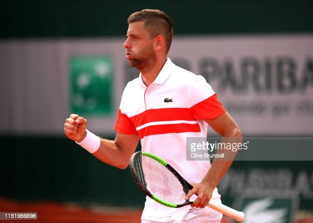 Filip Krajinovic of Serbia celebrates during his mens singles first round match against Frances Tiafoe of The United States during Day two of the...