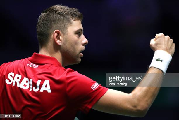 Filip Krajinovic of Serbia celebrates victory against JoWilfried Tsonga of France in the group stage during Day four of the 2019 David Cup at La Caja...