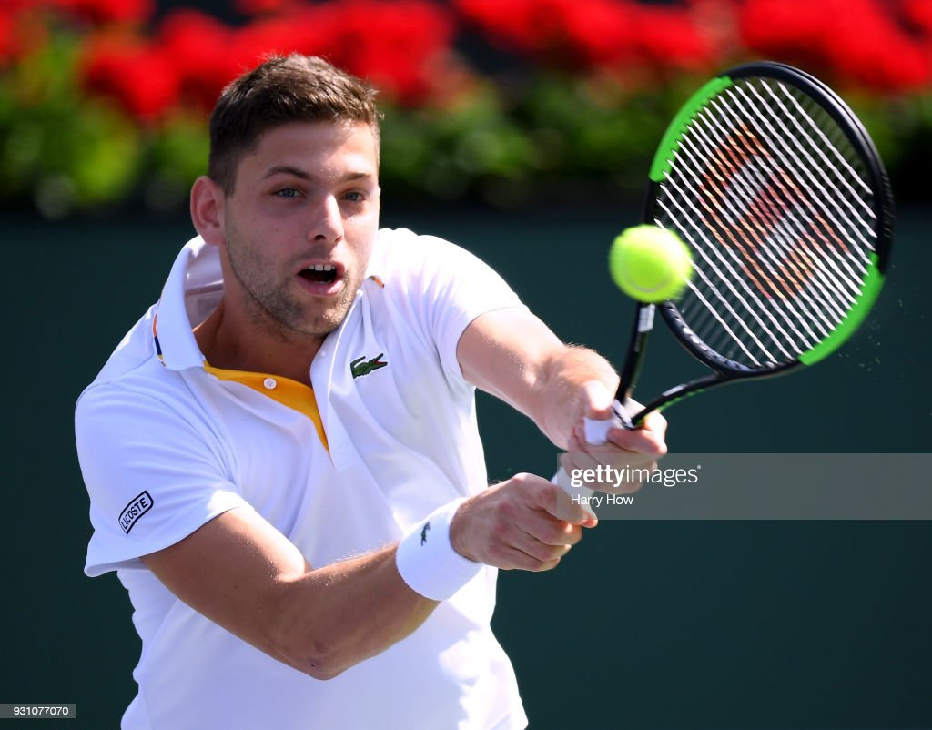 Filip Krajinovic of Serbia hits a backhand in his match against Roger Federer of Switzerland during the BNP Paribas Open at the Indian Wells Tennis Garden on March 12, 2018 in Indian Wells, California.