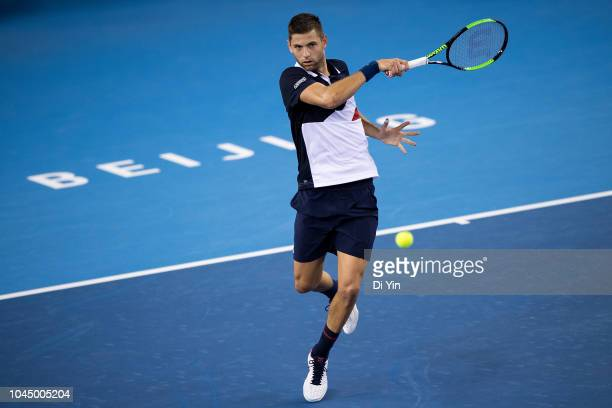 Filip Krajinovic of Serbia hits a return during his men's singles second round match of 2018 China Open against Feliciano Lopez of Spain at the China...