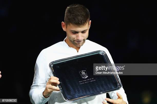 Filip Krajinovic of Serbia holds his runners up trophy after defeat against Jack Sock of the USA during the Mens Final on day 7 of the Rolex Paris...