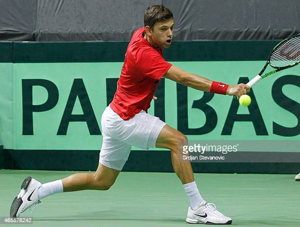 Filip Krajinovic of Serbia in action against Franko Skugor of Croatia during their men's single match on the day three of the Davis Cup match between...