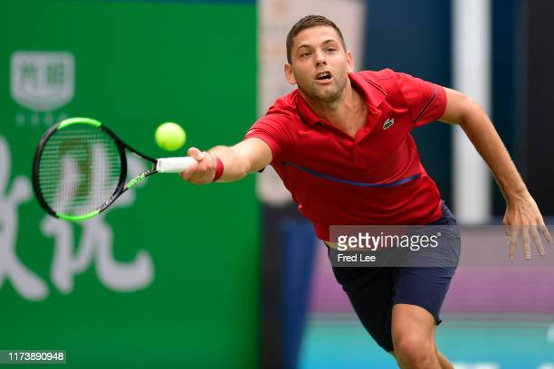 Filip Krajinovic of Serbia in action against Joao Sousa of Portugal during 2019 Rolex Shanghai Masters on Day 2 at Qi Zhong Tennis Centre on October...