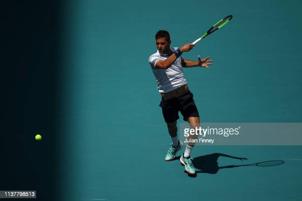 Filip Krajinovic of Serbia in action against Stan Wawrinka of Switzerland during the Miami Open Tennis on March 23 2019 in Miami Gardens Florida