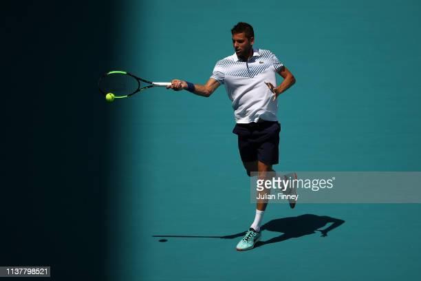Filip Krajinovic of Serbia in action against Stan Wawrinka of Switzerland during the Miami Open Tennis on March 23 2019 in Miami Gardens Florida