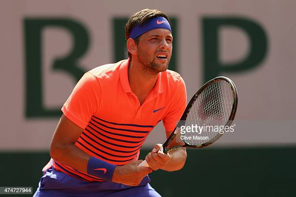 Filip Krajinovic of Serbia looks on in his Men's Singles match against David Goffin of Belgium on day two of the 2015 French Open at Roland Garros on...