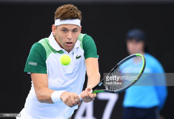 Filip Krajinovic of Serbia plays a backhand against Jannik Sinner of Italy during the 'A Day at the Drive' exhibition tournament at Memorial Drive on...