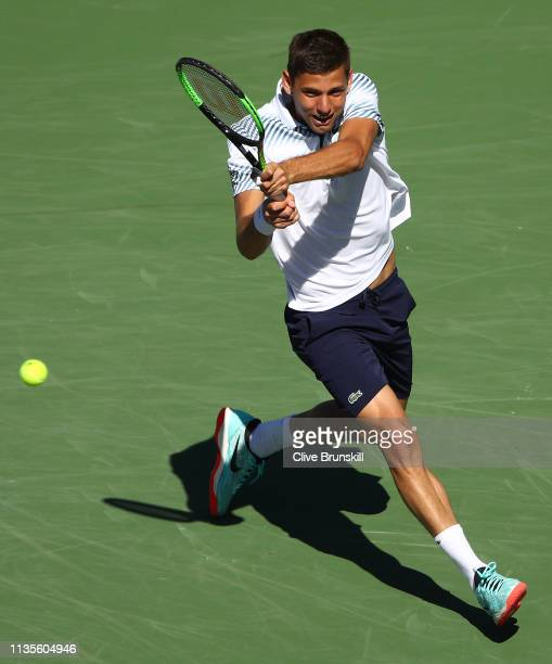 Filip Krajinovic of Serbia plays a backhand against Rafael Nadal of Spain during their men's singles fourth round match on day ten of the BNP Paribas...