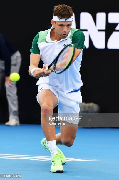 Filip Krajinovic of Serbia plays a backhand againstJannik Sinner of Italy during the 'A Day at the Drive' exhibition tournament at Memorial Drive on...